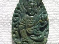 This Kwan Yin pendant has beautiful green tones with