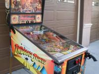 INDIANA JONES PINBALL BY WILLIAMS.  THE CABINET IS IN