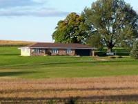 This 3-Bedroom Brick Ranch Home on an acreage near