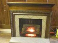 This is an indoor fireplace and mantle for the corner