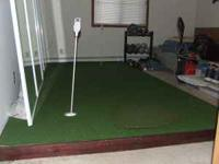 6' by 12' putting green with two pins and a chipping
