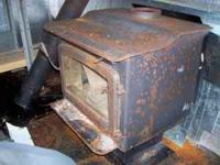 Indoor Wood Stove for sale. It was new within the last