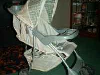 In good condition...khaki & green infant carseat, base