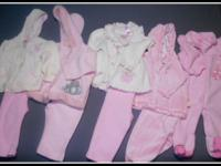 This set of baby clothes, in sizes from 6-9 months, is