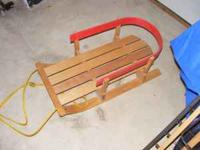 Infant wooden sled in great condition. Contact Tammy