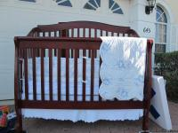 Dark wood with solid slats. Sleigh bed style crib
