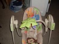 Safari theme infant travel swing, folds up to take it