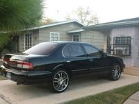 Selling Infiniti has sun roof, 20' rims, blk tinted