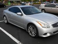 THIS INFINITI G37s SPORTS A SILVER LOOK WITH A SHARP