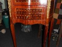 Beautiful and intricate wood inlay antique table. Metal