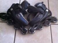 2 pair inline skates one is ozone the other corr small