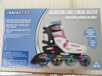 2 pair of Brand New Girls adjustable roller blades /