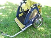 A used In Step Baby Bicycle Trailer. Needs a bicycle