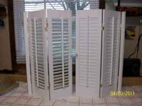 Interior window shutters. Shutters are 35 inches wide