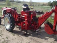 International 240 Utility Tractor with case Backhoe , 4