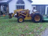 International 300 utiliy farm tractor with loader this