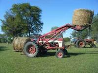 International 560 Gas Tractor with Loader and Rear Bale
