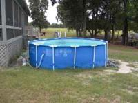 Pool is 15 feet round and 4 feet deep. Comes with pump,