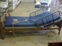 Semi-electric Invacare home care bed with upgraded