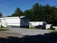 Well maintained mobile home park includes nine pads,