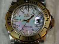 This is a ladies INVICTA 6895 watch in gold and