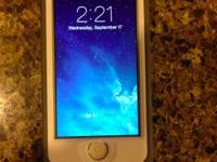 White Iphone 5c 16g AT&T with a White Lifeproof case.