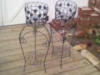 two decorative plant stands. have an ivy pattern. Sell