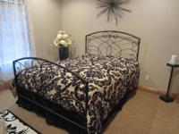 Iron scroll bed, queen size, black finish.  This bed