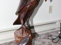 This is an Ironwood statue of an eagle over a rabbit.