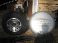 For sale is a tire, aluminum wheel and hard cover from