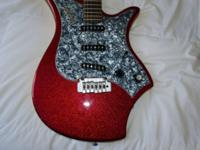 Sparkling red Italia Monza guitar. Definitely uncommon.