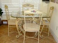 This wrought iron set has a distressed cream finish