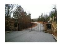 This 2.01 acre lot lies within a gated Lake Russell