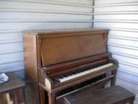 Early 1900's upright piano. Recipiant responsible for
