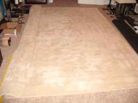 Pottery Barn Ivory color 100% wool rug. Size is 8x10.