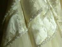 beautiful ivory satin brocade with gold thread floral