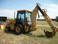 John Deere 310E extenda-hoe backhoe. With extra bucket