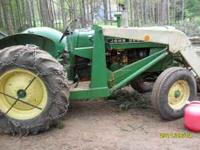 Great tractor runs great, front loader with bucket.