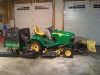 John Deere garden tractor X465 with 262 hours on it.