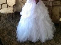 A remarkable size 10 J.J Kelly bridal gown with a full