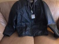 XL pleather coat with hood. New with tags connected.