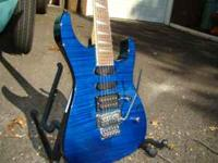 Translucent blue quilt. Comes w/hard shell case and