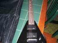 Jackson Randy Rhoads V with Jackson padded gigbag. No