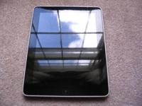 Apple ipad1 in like new condition with leather case and