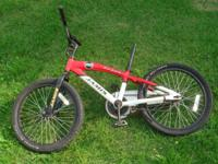 Offering a Jamis Laser 20 kid bike. Red and white in