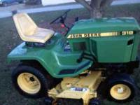 JD 318 riding mower with 48 inch mulching deck