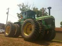 This is a 1981 JD 8640 4WD tractor with a 50-Series