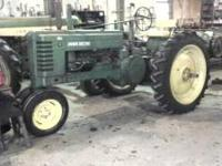 1950 JD B NEW 11-2-38 REAR TIRES, NICE RUNNINGTRACTOR.