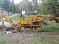 JD 450 TRACTOR WITH STREET GROUSERS, BACKHOE WITH TWO