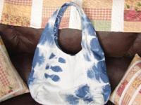 This is a handcrafted fish tote made from recycled